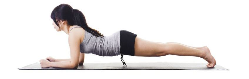 Woman doing the plank exercise to firm stomach muscles